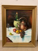 A 20th century Continental school, Still life with carafe of wine with raffia covering, signed lower