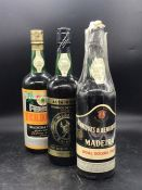 Three Bottles of Madeira Wine from various makers.