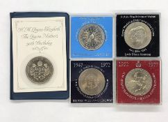 A Selection of cased coins, mainly crowns and a 1951 uncased Five Shilling coin.