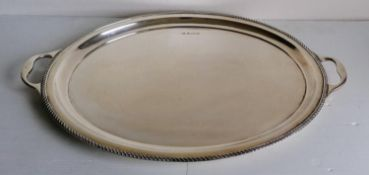 A George V silver two-handled oval butler's tray with gadrooned rim on pad feet, Birmingham, 1922,