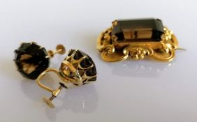 A Victorian smoky topaz brooch/pendant, the emerald-cut stone approximately 21mm x 15mm with c-