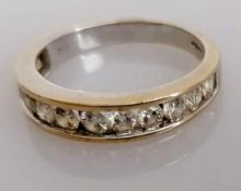 An 18ct white gold half-hoop diamond eternity ring with twelve graduated stones ranging from 0.05 to