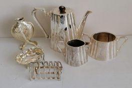 A three-piece silver plated coffee service, toast rack, oval bon-bon dish and a Christofle vase '