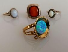 A yellow gold opal ring in the Grecian style, size P, stamped 9kt, 4.2g and three silver gem-set