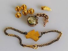 An assortment of 9ct gold items to include compass, map of Australia, hallmarked and five dress