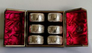 A cased set of six Victorian silver napkin rings with etched decoration, vacant cartouches, by Hayes