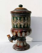 A Doulton Lambeth stoneware water filter with original spigot, relief moulded foliate decoration
