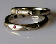 A Jeremy Hoyle carved 18ct white gold ruby and diamond eternity ring, size K and another similar