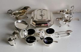 A selection of Garrard & Co. Regent plate to include: entree dish, pair of sauce boats, one other,