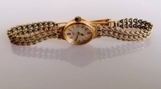 A gold mid-century ladies Rotary dress watch with mesh bracelet, hallmarked 9ct, 10.83g
