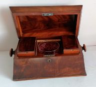 A Georgian mahogany sarcophagus tea caddy with shaped top, fitted interior with etched glass