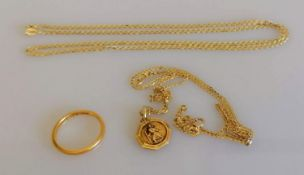 A 22ct yellow gold wedding band, size M 1/2, 2.62g; a 9ct yellow gold St. Christopher pendant and