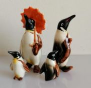 A Beswick penguin family of four, without damage or repair