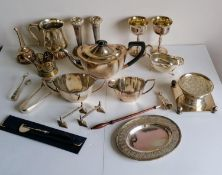 A selection of silver plated items to include a three-piece Unity Plate tea service, goblets, wine