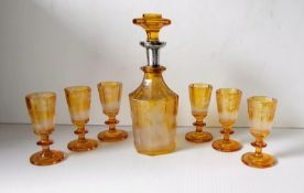 A 19th century Bohemian amber glass decanter with silver collar, 20.5 cm, etched glade scene,