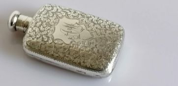 A late Victorian silver hip flask with seaweed etched decoration, filled cartouche, screw cap (