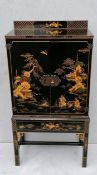 A Meiji period lacquered cabinet with Shibayama inlaid decoration, twin doors revealing a shelved