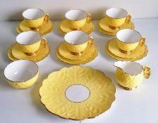 An Art Deco Aynsley lemon yellow butterfly-handle tea set comprising six teacups, saucers, side