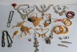 An assortment of Indian silver and silver-gilt bridal jewellery to include three pairs of bangles,