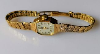 A mid-century ladies Rotary manual dress watch with baton markers, hallmarked 9ct gold case and