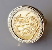 A George V gold full-sovereign ring on a 9ct gold mount, hallmarked, size K, dated 1913, Melbourne