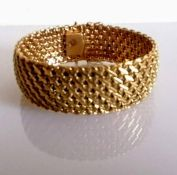 A 9ct yellow gold mesh bracelet, stamped, 48.08g