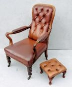 A George IV walnut-framed library or club chair with later footstool, leather button-back