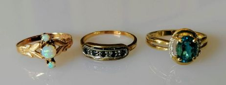Three gem-set, 9, 10 and 14ct gold rings, sizes L, M, O, stamped, 5.7g