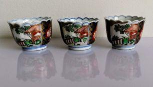 A set of three Japanese Imari sake or tea bowls with underglaze blue and overglaze polychrome