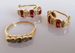 A pair of garnet and diamond earrings, stamped 14k and a 5-stone illusion-set diamond ring, size P