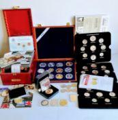 A cased set of twelve 2 Euro Commemorative Coin Set to include Luxemburg x 3, Finland x 4, Belgium x