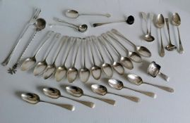 A George III set of twelve crested teaspoons, two salt spoons and a ladle by George Smith IV,