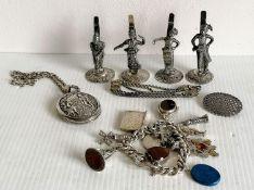 A set of four Edwardian Burmese silver place holders, each 7 cm H; an Islamic silver bracelet,