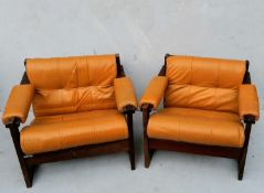 A pair of Percival Lafer lounge chairs with hardwood frames and leather upholstery, labelled Lafer