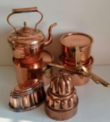 Two Victorian shaped copper jelly moulds, three graduated tin-lined copper pots with lids