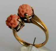 A mid-century carved coral crossover ring on a 9ct yellow gold shank, size N, hallmarked 4.14g