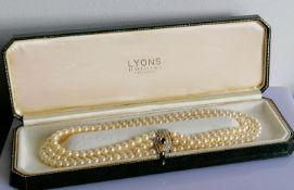 An Art Deco-style three-row cultured pearl necklet on an 18ct white and yellow gold lozenge-shape