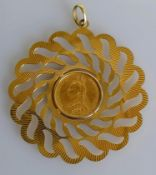 A Victorian gold full-sovereign, 1888, on a pierced 9ct gold mount, diameter 7 cm, hallmarked, 18.
