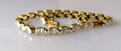 A 14ct yellow gold line or tennis bracelet with cubic zirconia decoration, box clasp, 20 cm,
