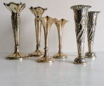 A George V pair of silver posy holders by Henry Matthews, Birmingham, 1919, 14 cm H; a Victorian