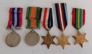 A WW2 medal group to include: 1939-1945 medal, Defence medal and replicas of Pacific Star, France