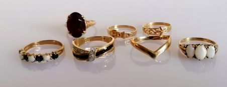 An assortment of seven yellow gold rings, some gem-set, all hallmarked or stamped 9ct, various sizes