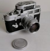 A cased Leica M3 camera, chrome, serial no. 914996, 1957, shutter working, with a Leitz Wetzlar