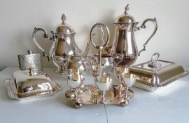 An assortment of silver plate to include a four-piece tea and coffee service, two food warmers, an