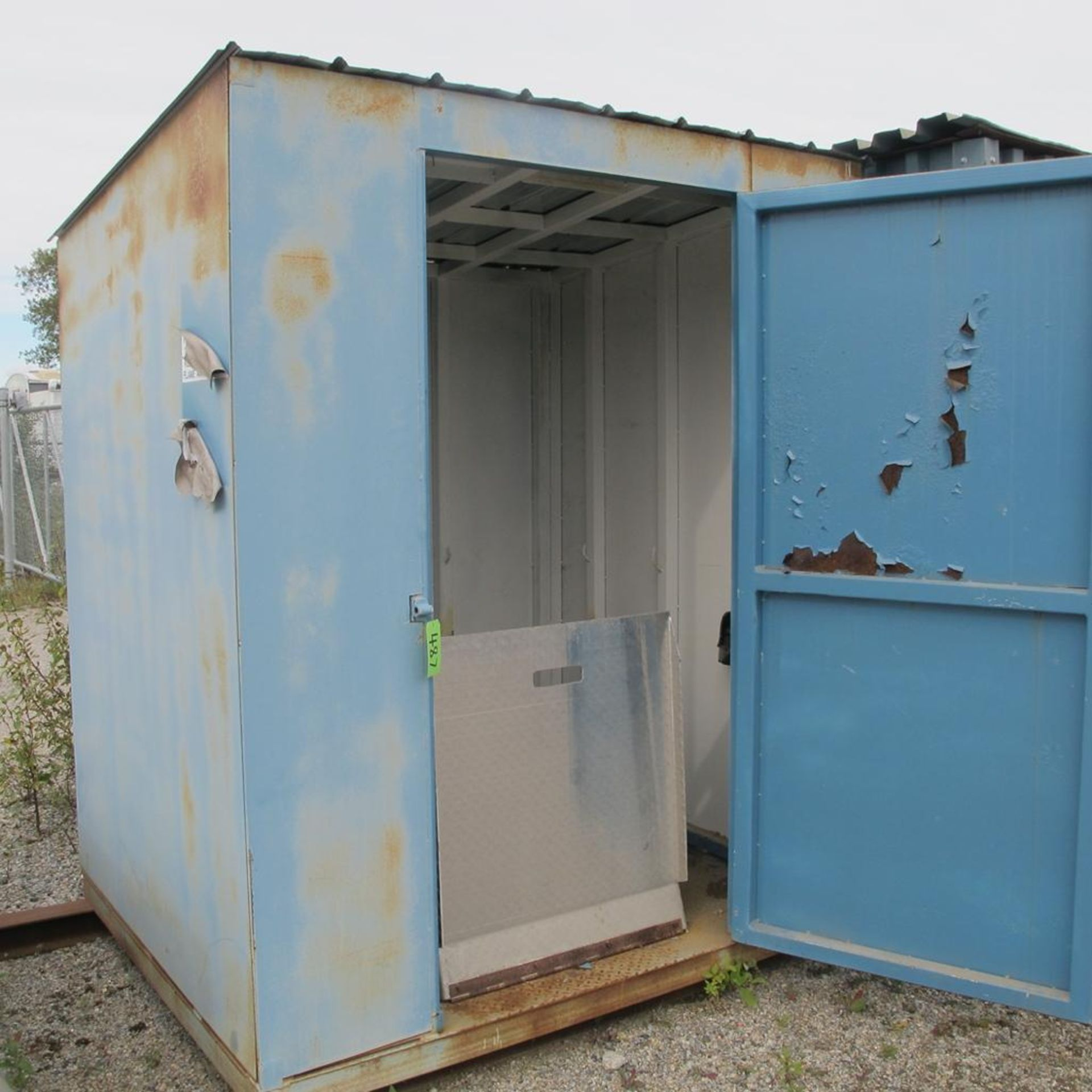 Lot 487 - PORTABLE STEEL GAS STORAGE SHED WITH FOLD DOWN RAMP (WEST YARD)