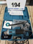 A MAKITA Model 9554NB 115mm 240V Angle Grinder in Blow Moulded Case