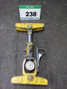 A Pogo Stick Clamp Force Testing Device with Analogue Dial, Calibrated to 25/08/2021 with