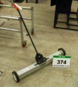 A CLARKE Model Ms36B Magnetic Sweeper