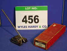 A 12 inch Gauge Stand in Red Cardboard Box