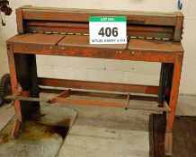 An F.J. EDWARDS 48 inch Treadle Operated Sheet Metal Guillotine, Serial No. C6186